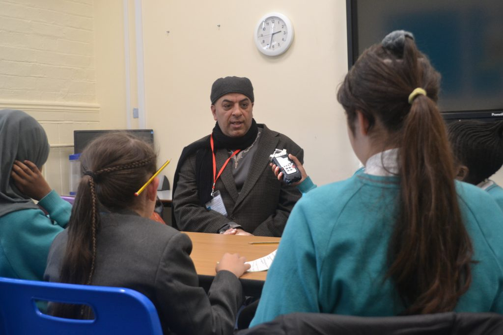 Actor Haqi Ali talks to school children at Ark Tindal about growing up in Balsall Heath, the significance of Balsall Heath Adventure Playground / The Venture on the rest of his life, long summers, 'Batman Park' & the importance of the imagination.