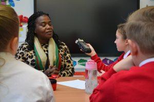 Children at St Annes Primary School, Chelmsley Wood interviewing Meriden adventure playground volunteer Sharon Dunbar.